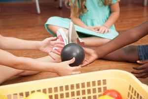 Kids playing with plastics balls