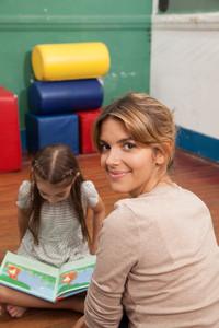 Kids reading a book in a kindergarten class