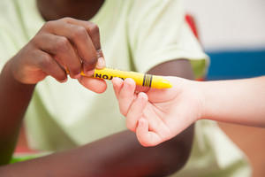 Kids sharing one pencil