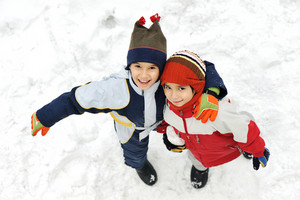 Kids together on snow standing