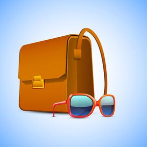 Ladies Handbag And Sunglasses On Blue