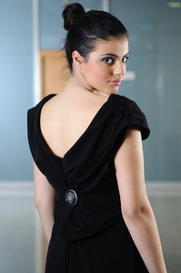 Lady on black dress look back