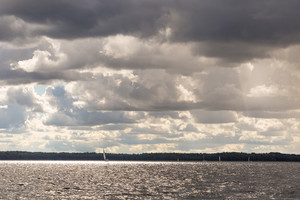 Lake landscape at storm photographed from yacht. Landscape with yachts on lake. Mazury lake district.