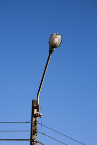 lamp post on blue sky ; electricity industry