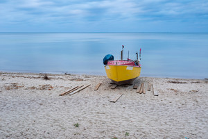 Landscape with Baltic Sea. Fishing boat on the beach. Tranquil evening landscape.--