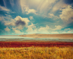 Landscape with beautiful cloudy sky and salt lake