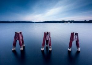 Landscape with metal construction on city beach of Olsztyn in Poland. Long exposure landscape with architecture elements.