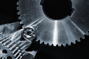 large cogs and gearsd against black backdrop