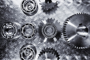 large cogwheels and ball-bearings, titanium and steel, aerospace-parts