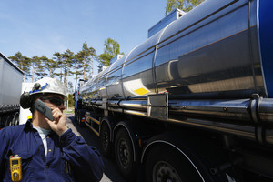 large fuel and oil truck being loaded