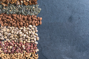 Large Group Of Nuts On Dark Background