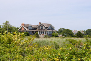 Large luxury homes in a coastal country setting.