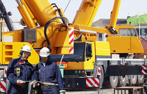 large mobile cranes with two building workers