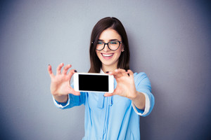 Laughing businesswoman making selfie photo