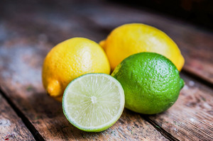 Lemon And Limes On Rustic Wood