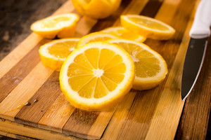 Lemon Slices On Cutting Board