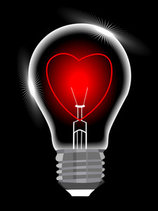 Light Bulb With Heart Against Black Background
