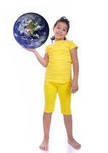 Little beautiful girl in yellow with Earth ih hand