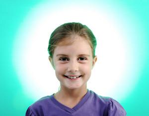 Little blonde girl portrait smiling