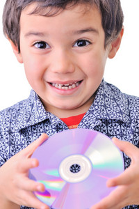 Little boy holding cd dvd
