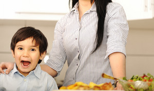 Little boy in kitchen with mother