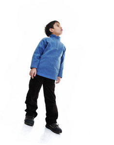 Little boy isolated on white looking up