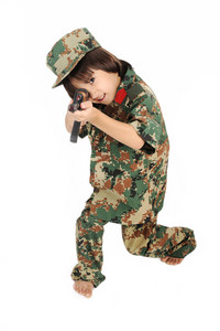 Little boy shooting from a gun isolated