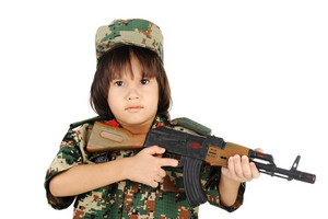 Little boy with gun and military uniform