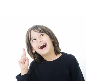 Little boy with idea showing finger upward