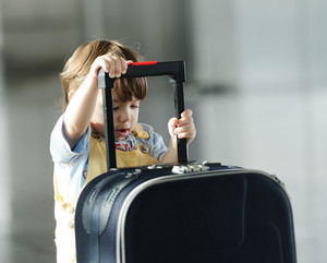 Little cute baby with bag on airport traveling