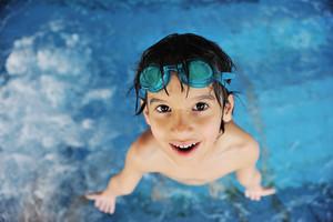 Little cute boy at pool