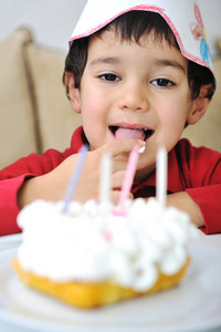 little cute kid and his birthday cake