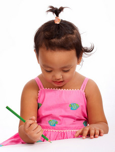 Little Girl Focused On Drawing A Picture