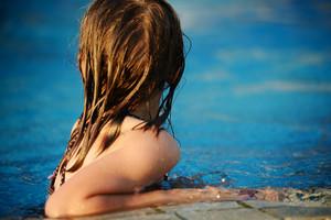 Little girl on pool