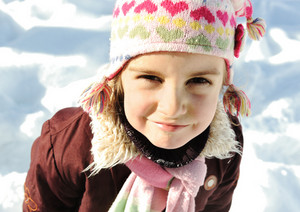 Little girl portrait in snow, winter