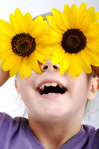 Little girl with sunflower