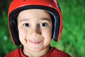 Little kid with biking safety helmet portrait