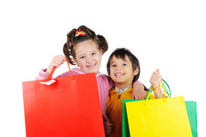 Little kids with shopping bags