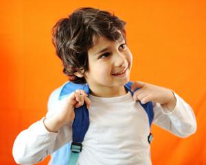 Little school cute boy with backpack