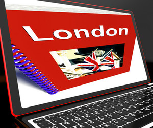 London Book On Laptop Shows Britain Guide