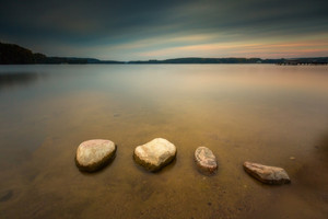 Long exposure landscape of polish lake shore. Lake Krzywe in Olsztyn