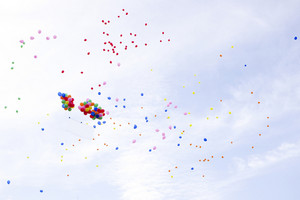 Lots of colorful balloons on the sky background