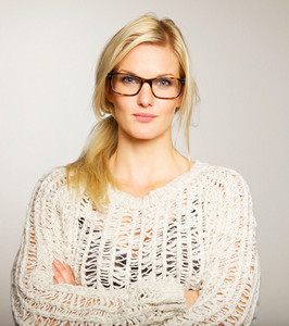 Lovely and smart woman with blank expression wearing her eyeglasses