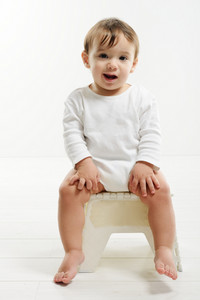 Lovely baby sitting in chair