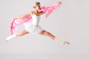 Lovely ballet dancer jumping exercising in studio woman ballerina rehearsal