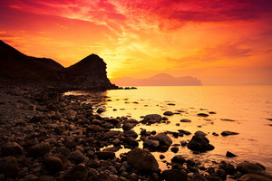 Magic red sunset over a rocky coast