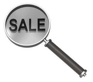 Magnifier With Sale Sign Isolated On White.