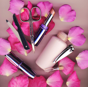 Makeup Brush And Cosmetics With Rose Petals