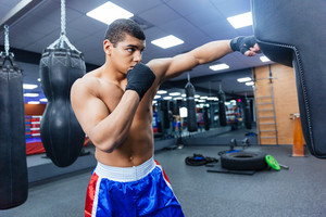 Male boxer training in gym