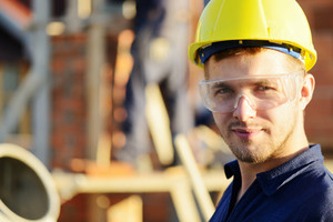 Male construction worker smiling at a building site